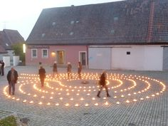 Very elegant, lit labyrinth. Rödelsee (Germany) 2011. The labyrinth had 4 circuits with an additional short path, the path width was 1 m, the middle had 4 m of diameter, the whole diameter amounted to 12 m, the lines were 122 m long and the way to the middle had 100 m.