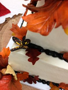 Hand made sugar paste leaves and sugar butterfly. #Fall wedding #autumn theme