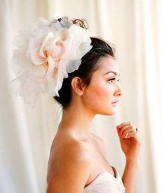Bride's curly bun updo bridal hair ideas Toni Kami Wedding Hairstyles ♥ ❶ huge peach flower