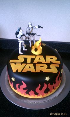 star wars Birthday cake - This cake was for a 6 year olds birthday cake that wanted flames and starwars. Flames and starwars logo made from frosting sheets, cut by hand (since cricut doesn't have that cartridge) and airbrushed.