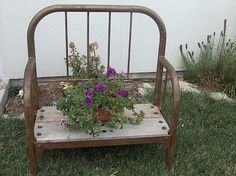 Looks like a cute bench made out of a metal bed frame....nice idea!!