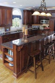 From Ordinary To Opulent: A Full Kitchen Renovation (love the color of the cabinets)