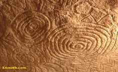 Amazing megalithic art carved on the underside of the roof stone in the east recess off the main chamber inside the mound at Newgrange.