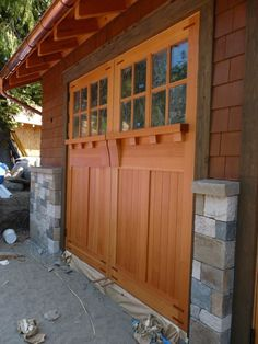 Wooden carriage style garage door - The Garage Journal Board.  How cool would barn doors look like this?!?!