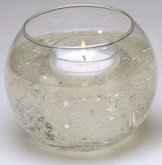 Silver Star Fishbowl Table Centerpiece. Could I do this with blue water? Or a yellow tinted candle?