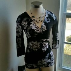 WHBM....GORGEOUS FLOWER...TOP.. ...EXCELLENT CONDITION  ...LIKE NEW  ...NO FLAWS  ...GORGEOUS  ...A MUST HAVE ...true to its size and color ..2 pic up close ...ruched.. style.. ...3/4 ..sleeves ...V front and back  ...gorgeous design throughout  ...flowers. ..Deco.. ...MTRL....adding soon... ...better in person.. White House Black Market Tops Blouses