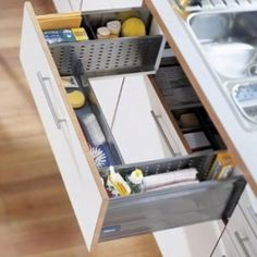 This unique shape drawer under the kitchen sink is quite an interesting idea to try.