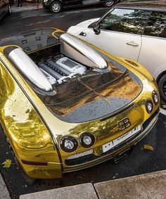 A gold bugatti, because the original one wasnt expensive enough. - A gold bugatti, because the original one wasnt expensive enough. Maserati, Volkswagen, Bugatti Veyron Gold, Bugatti Chiron, Gold Lamborghini, Auto Body Repair Shops, High End Cars, Most Expensive Car, Sweet Cars