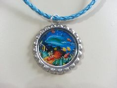 Dolphin at Play Bottle Cap Necklace by KristyJsCreations on Etsy, $5.99