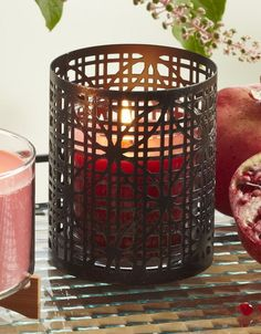 Daisy Cane Candle Sleeve.  Intricate metal cutwork mimics the look of traditional woven cane. A pillar or jar candle, sold separately, highlights the floral pattern beautifully.