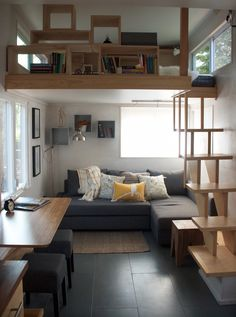 liberation tiny homes living space. A sectional sofa fits into the corner of the living room, keeping the path through the home clear, and doubles as a bed for guests.
