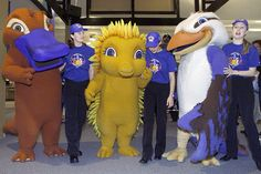 Syd the platypus, Millie the echidna and Olly the kookaburra, the Sydney 2000 Olympic Mascots, pose with volunteers at the Main Press Centre at Olympic Park, September 12, 2000. The mascots were created by Australian animator Matthew Hatton. (Photo by Claro Cortes/Reuters)