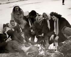 Ice skaters warm up around a bonfire in Forest Park, 1 January 1947. Missouri History Museum