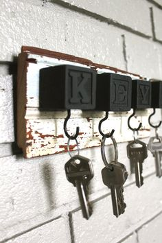 Spray paint kids' blocks for a DIY key holder.