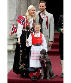 The Norwegian royal family poses for a picture with their family dog, Milly Kakao, as they celebrate Norway National Day in Asker, Norway.