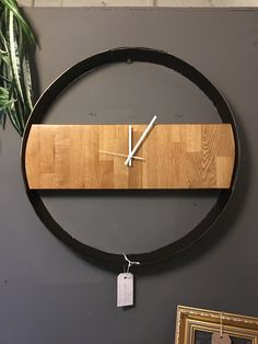 Reclaimed oak and steel clock. Made from a recycled whiskey barrel hoop. @whiboxfurniture