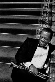 THE SMILE AND THE TRUMPET… Louis Armtrong on stairs