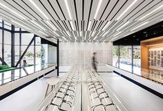 A white spectacles showroom contrasts with black examination areas at this eye clinic near Montreal by Canadian studio La SHED Architecture. Lighting Concepts, Linear Lighting, Lighting Design, Medan, La Shed Architecture, Agi Architects, Retail Facade, Eyewear Shop, Higher Design