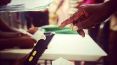 A Nigerian has his fingerprint checked before voting in Lagos, Saturday 28 March 2015
