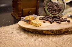 Dark Chocolate bars and coffee beans on wooden chopping board
