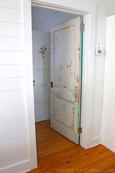 House of Turquoise: Cottage on the Green - Tybee Island Cottage Door, Cottage Homes, Cottage Style, Wood Plank Walls, Wood Planks, House Of Turquoise, Turquoise Cottage, Tall Cabinet Storage, Locker Storage
