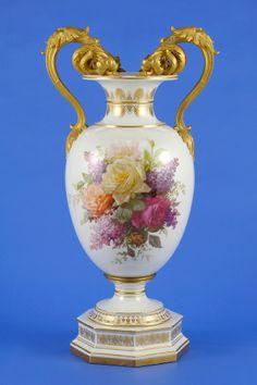 KPM (Berlin,Germany) — Vase. Painted floral bouquet . Gilded. Vegetable Henkel ending in plastic flowers. Maskerons.H:74 cm. Llate 19th Century(666×1000)