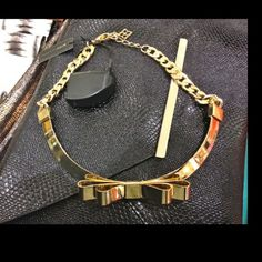 BCBG Gold Bow Necklace Choker Gold bow necklace/choker. Matching anklets also available. NWT BCBGMaxAzria Jewelry Necklaces