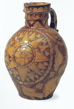 Potters in the West Country (Somerset, North Devon and even South Wales) disguised their brick-red clays with an entire coat of white slip, on which stylised floral decoration and inscriptions could be incised with a point or carved. Popular thems on the big harvest jugs were nautical compasses, hearts, tulips and birds.