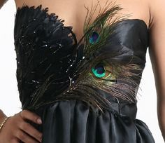 Peacock feathers ... i think this would be pretty on a teal dress too! :) @Ali Gonzales