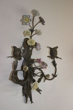This delicate and pretty antique wall light dates back to around the 1920's.... view it here - http://www.antiquelightingandchandeliers.co.uk/antique-wall-lights-circa-1920_item_11924