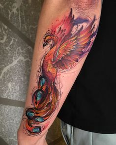 20 Phoenix Tattoos to Show Off Moms' Inner Fire Phoenix Tattoo Feminine, Phoenix Bird Tattoos, Phoenix Tattoo Design, Phoenix Tattoo Sleeve, Watercolor Phoenix Tattoo, Phoenix Back Tattoo, Rising Phoenix Tattoo, Phoenix Design, Phoenix Art