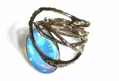 Rope Ring, in opal and black gold. THIERRY VENDOME