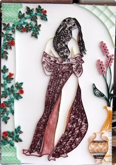 A quilled woman's figure - by: a Russian artist