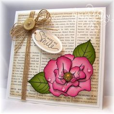 card with beautifully colored wild rose...like the use of book paper, dew drops and twine...