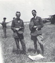 T.E. Lawrence (on left). I believe this was taken in May 1919, days before he survived a plane crash in Rome which killed both pilots. Lawrence was the only survivor.