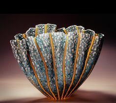 """MEL MUNSEN - Kilnformed Glass. His current fusing and murrini techniques is a fascination with Italian glass maker Venini's designs. He produces incredible detail by maintaining a fine tuned balance of proportion and symmetry. He grinds and polishes his pieces until they are unusually thin but produces a transparency rarely found in fused and slumped glass. He uses both murrini and fused cane for the majority of the detail in his designs. Fused and slumped glass MURRINI, 9 """"x 13"""" x 10 """""""