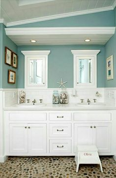 Shauni's bathroom - same blue paint as in bedroom, but add tan ('sand colored') and white beach themed accessories. Consider leaving 1 - 1 1/2 foot white paint border at the top of the wall...makes room look taller