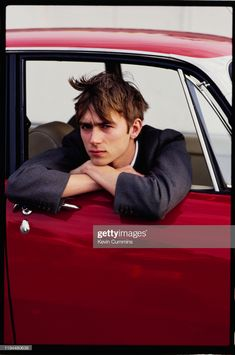 Singer-songwriter Damon Albarn sitting on a Rover at Clacton Pier,. Damon Albarn Young, Indie Men, Blur Band, Rover P6, Handsome Male Models, Sanaa Lathan, Toni Braxton, Aesthetic People, Britpop
