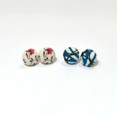 Fabric Earring Set, $18. Two is always better than one! Featured in this two pack are a set of blue and black geometric patterned studs, along with a white floral fabric pair. Created from reclaimed fabric.