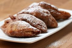 Ooey gooey apple turnovers made out of cinnamon roll dough and fried.