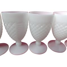 Here is a set of six, unmarked, English Hobnail Goblets or stems in milk-glass.  Each stem is 5-1/2 inches tall with a round foot and a number on the