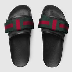 Shop the Satin slide with Web bow by Gucci. The slide sandal features a wide satin strap with oversize Web bow. First developed by Gucci in the 1950s, the Web stripe continues to pay homage to the House's roots.