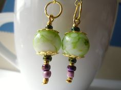 Cool beauty green beads with purple color dangling earrings.
