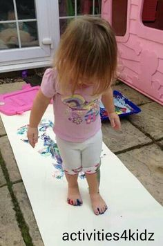 Painting With Your Feet Sensory Play.  Visit pinterest.com/arktherapeutic for more #sensory activities