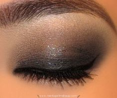 Moderate smokey with a bit of shimmer on the center lid.