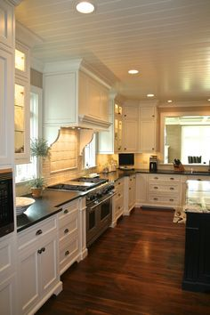 I know we aren't doing countertops yet, but I'm surprised to find that I keep getting drawn to off white kitchens with black countertops.