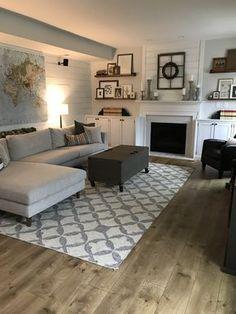 Modern Farmhouse living room - Interior Define Sofa, West Elm Kilim Tile Rug, Sherwin Williams Frosty White, Shiplap, Floating shelves around fireplace