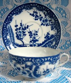 Antique Japanese Blue And White Cherry Blossoms Cup And Saucer antique teacup made of egg shell porcelain from Japan 1910-1920