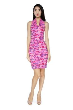 This edgy dress combines some elements of traditional cheongsum and modern-day pencil dress to create an easy to wear number. The combo of high collar, yellow piping and pink camouflage print made this dress so much more desirable. Fully lined.