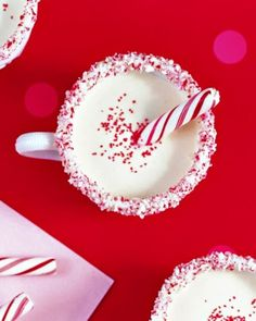 Peppermint Eggnog is great for a party that is kid friendly. It's a nonalcoholic eggnog flavored with peppermint and vanilla. Just garnish the cups with melted white chocolate and crushed candy canes! #holiday #party #recipe